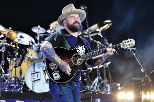 a man standing on a stage: Zac Brown of Zac Brown Band
